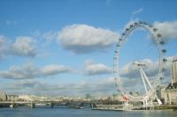 London Eye Soaring Above The Thames